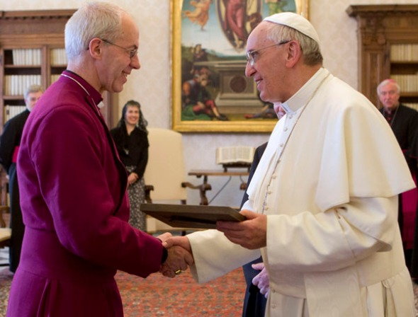 Pope Francis exchange gifts with Archbishop of Canterbury Welby during a private audience at the Vatican